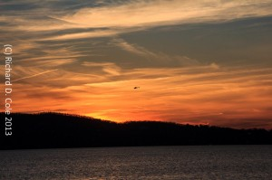 Sunset Over the Hudson with Government Chopper by Richard D. Cole